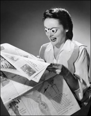 woman reading newspaper - gettyimages