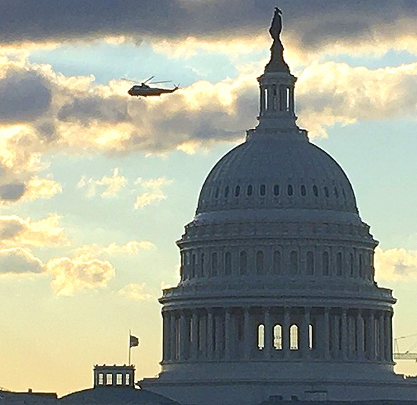 Capitol with Trump heli and American flag